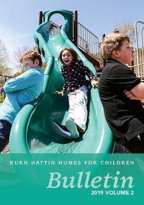 Kurn Hattin Girl on Slide Bulletin Cover